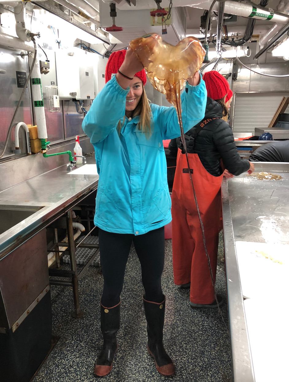 Kaila holds up sea nettle