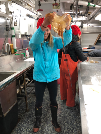 Kaila holds up sea nettle