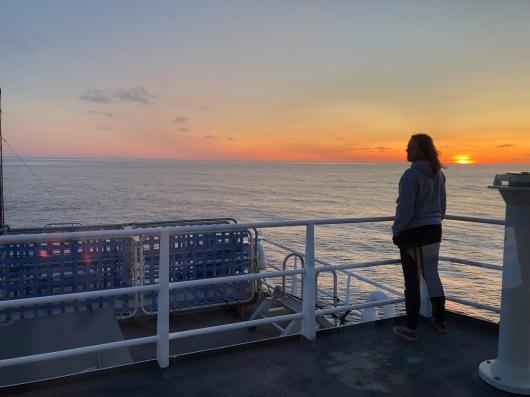 Abigail watches sunrise