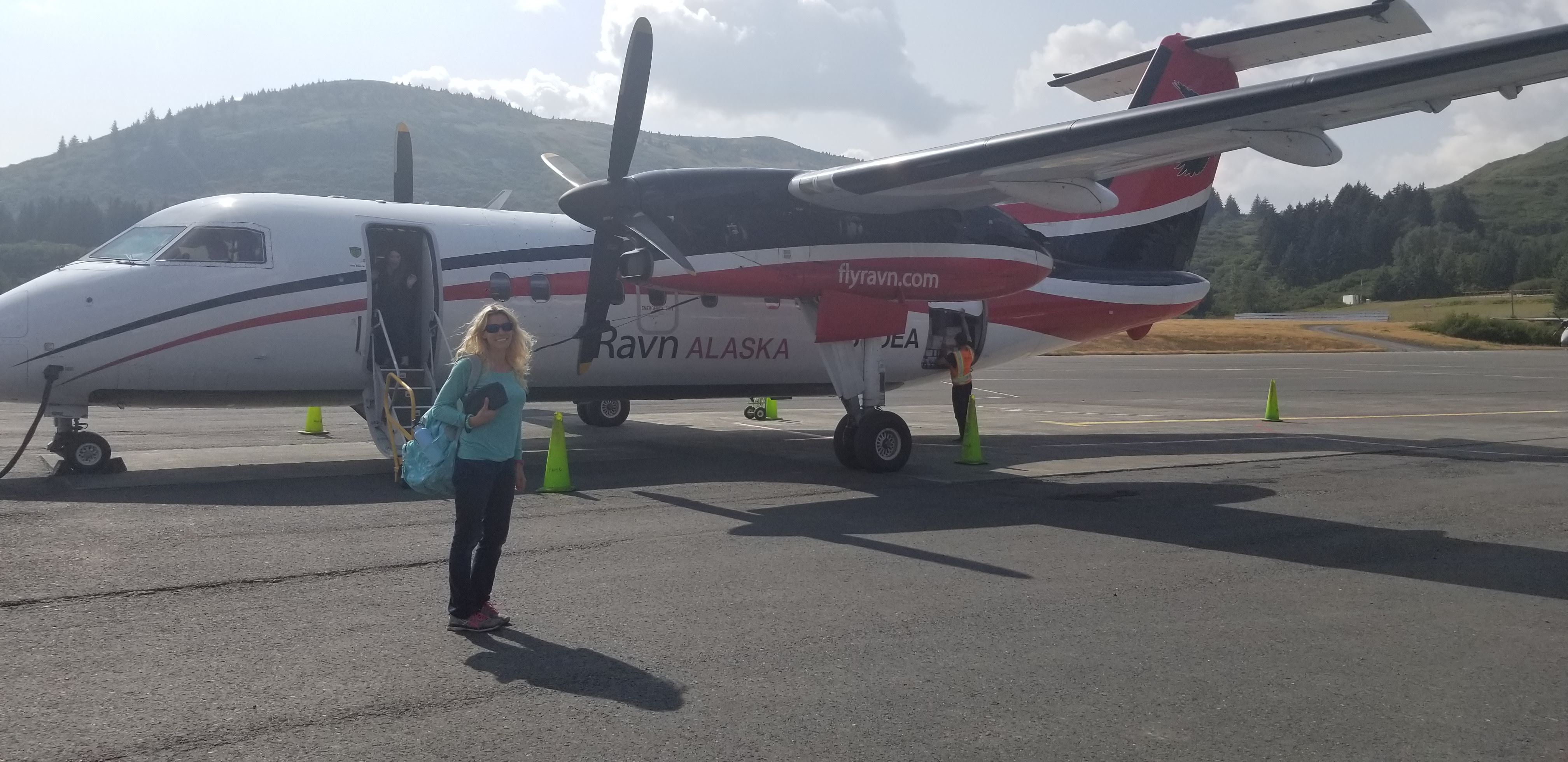 Callie in front of plane